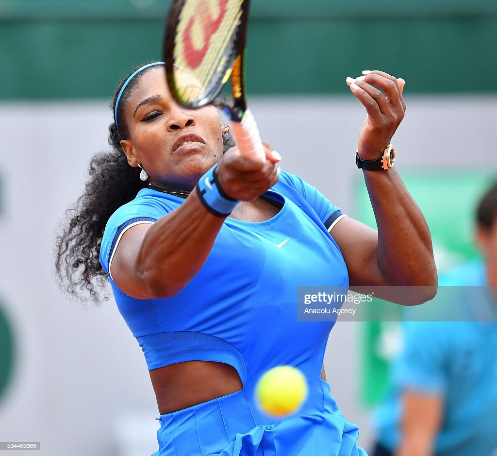 US's Serena Williams returns to Brazilian Teliana Pereira (not seen) during their women's single second round match at the French Open tennis tournament at Roland Garros in Paris, France on May 26, 2016.