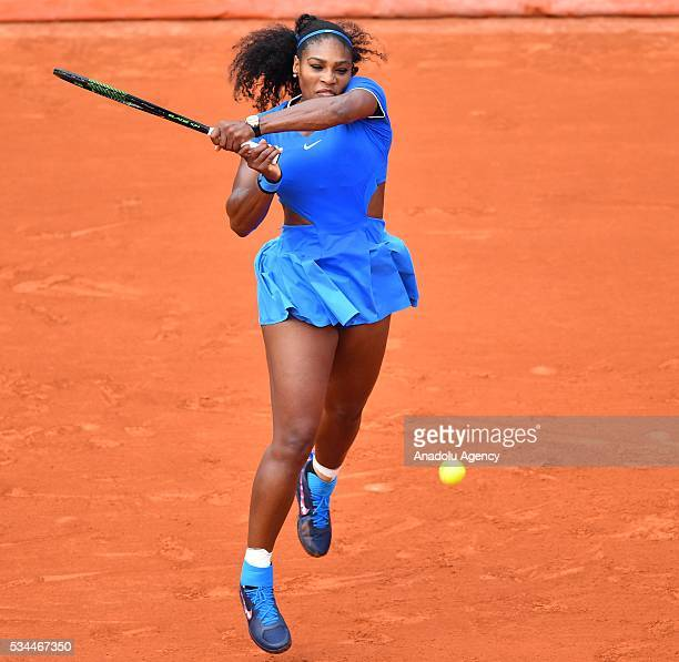 US's Serena Williams returns to Brazilian Teliana Pereira during their women's single second round match at the French Open tennis tournament at...