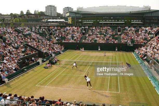 USA's Serena Williams serves as Serena and Venus Williams play Dominika Cibulkova and Anastasia Pavlyuchenkova during day six of the 2010 Wimbledon...