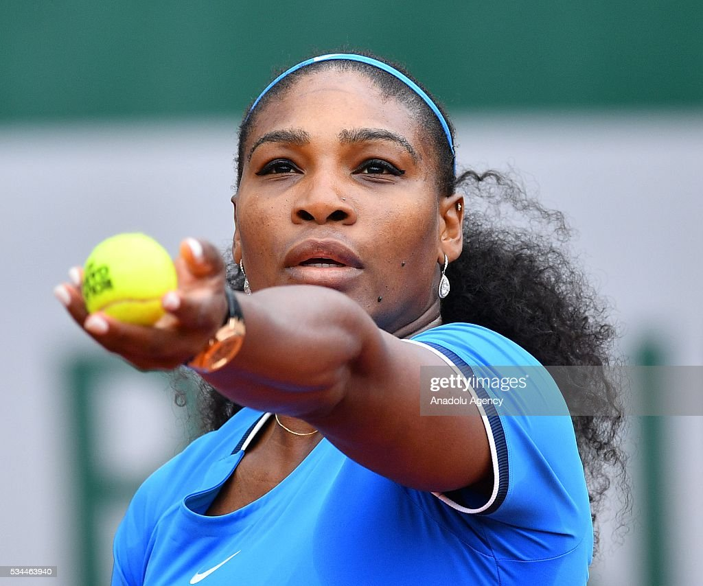 US's Serena Williams serves to Brazilian Teliana Pereira (not seen) during their women's single second round match at the French Open tennis tournament at Roland Garros in Paris, France on May 26, 2016.