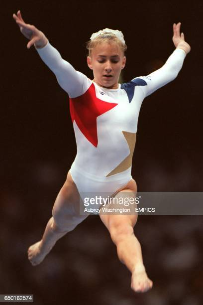 USA's Shannon Miller leaps on the beam