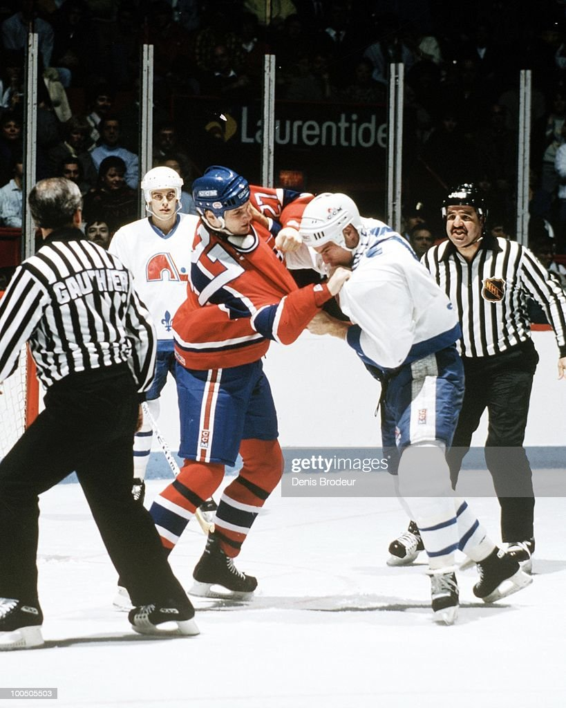 MONTREAL - 1980's: Shayne Corson #27 of the Montreal Canadiens fights against an opponent on the Quebec Nordiques in the late 1980's at the Montreal Forum in Montreal, Quebec, Canada.