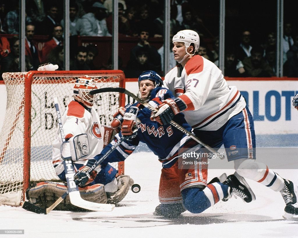 MONTREAL - 1980's: Shayne Corson #27 of the Montreal Canadiens skates against the New York Rangers in the late 1980's at the Montreal Forum in Montreal, Quebec, Canada.