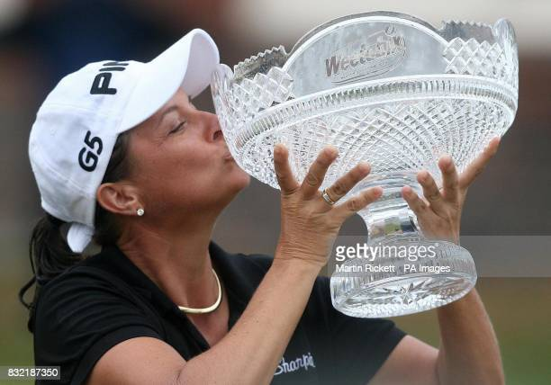 USA's Sherri Steinhauer celebrates with the trophy after winning the Weetabix Women's British Open at Royal Lytham and St Annes Lancashire