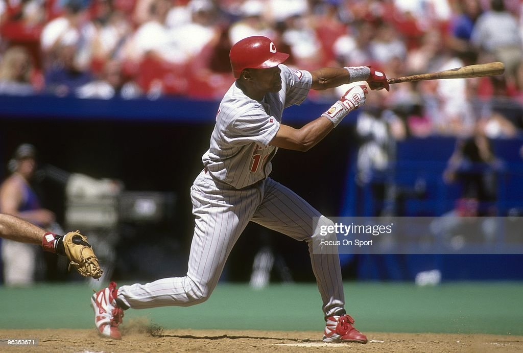 Shortstop <a gi-track='captionPersonalityLinkClicked' href=/galleries/search?phrase=Barry+Larkin&family=editorial&specificpeople=204522 ng-click='$event.stopPropagation()'>Barry Larkin</a> #11 of the Cincinnati Reds swings and watches the flight of his ball during a MLB baseball game circa 1990's. Larkin played for the Reds from 1986-04.