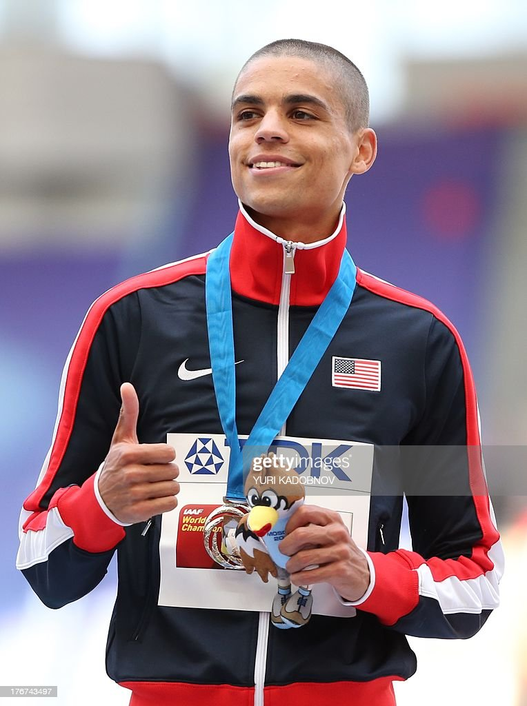 US's silver medallist Matthew Centrowitz gives a thumbs-up on the podium during the medal ceremony for the men's 1500 metres at the 2013 IAAF World Championships at the Luzhniki stadium in Moscow on August 18, 2013. AFP PHOTO / YURI KADOBNOV