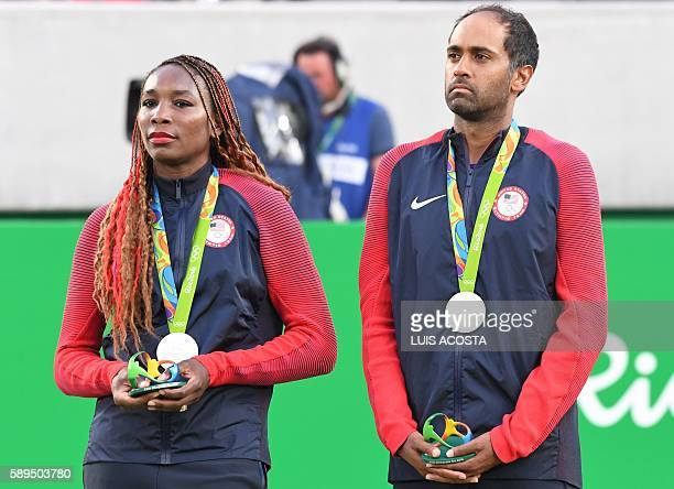 USA's silver medallists Venus Williams and Rajeev Ram pose on the podium during the medal ceremony for the mixed doubles tennis event at the Olympic...