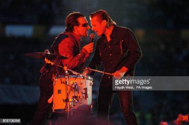 U2's singer Bono and drummer Larry Mullen on stage during the second Irish date of their Vertigo Tour