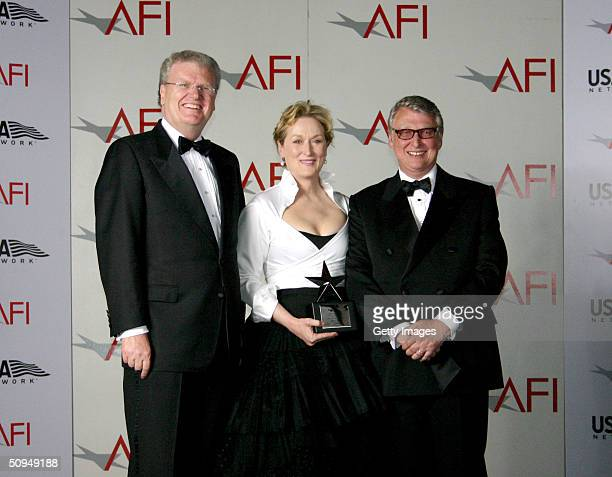 AFI's Sir Howard Stringer actress Meryl Streep and director Mike Nichols pose during the 32nd Annual AFI Lifetime Achievement Award tribute gala in...