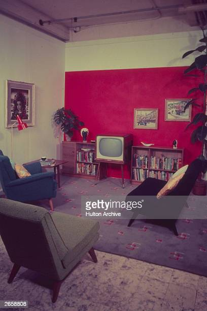 A 1950's sitting room complete with red panelled wall and television set