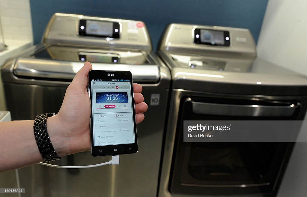 LG's smart wash and dryer with Smart ThinQ technology are seen at the 2013 International CES at the Las Vegas Convention Center on January 8, 2013 in Las Vegas, Nevada. The home appliance is able to communicate with the user's smartphone. CES, the world's largest annual consumer technology trade show, runs through January 11 and is expected to feature 3,100 exhibitors showing off their latest products and services to about 150,000 attendees.