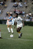 BRONX NY CIRCA 1970's Soccer player Pele of the New York Cosmos dribbles the ball during a NASL soccer game mid circa 1970's at Yankee Stadium in...
