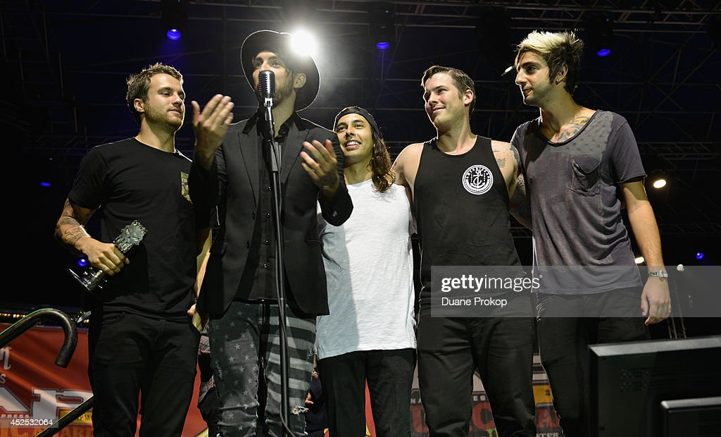 APMA's Song Of The Year Award Winners All Time Low and Vic Fuentes for A Love Like War at the 2014 Gibson Brands AP Music Awards at the Rock and Roll Hall of Fame and Museum on July 21, 2014 in Cleveland, Ohio.