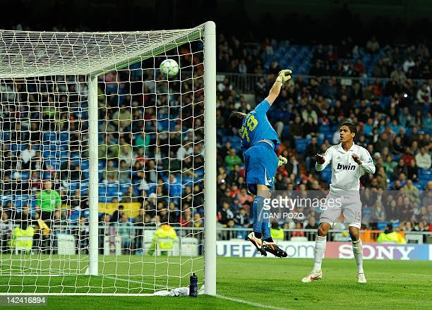 APOEL's Spanish goalkeeper Urko Pardo fails to stop a ball shot by Real Madrid's Portuguese forward Cristiano Ronaldo during the UEFA Champions...