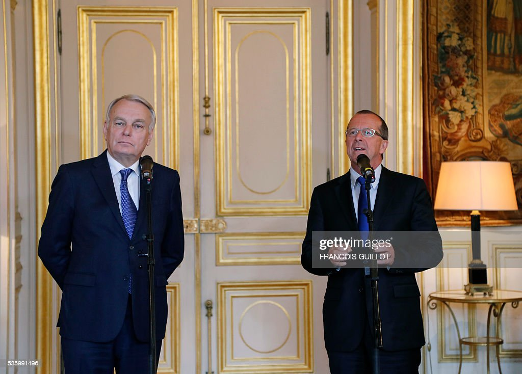UN's special envoy on Libya Martin Kobler (R) speaks next to French Foreign minister Jean-Marc Ayrault (L) during a meeting on May 31, 2016 in Paris. Kobler called on all the country's armed groups to unite against the Islamic State (IS) group. Kobler and Ayrault reaffirmed their support for the UN-backed unity government set up in the capital two months ago. / AFP / FRANCOIS