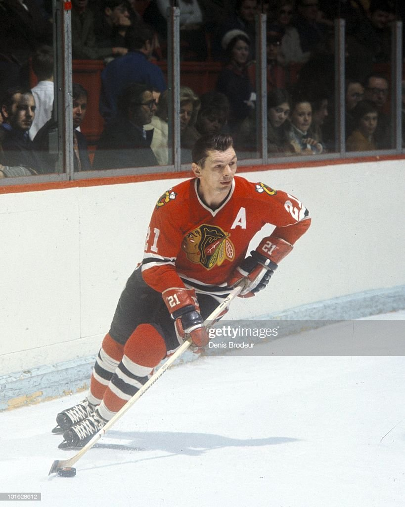 MONTREAL - 1970's: <a gi-track='captionPersonalityLinkClicked' href=/galleries/search?phrase=Stan+Mikita&family=editorial&specificpeople=1691052 ng-click='$event.stopPropagation()'>Stan Mikita</a> #21 of the Chicago Black Hawks skates against the Montreal Canadiens in the early 1970's at the Montreal Forum in Montreal, Quebec, Canada. Mikita played for the Black Hawks from 1958-1980.