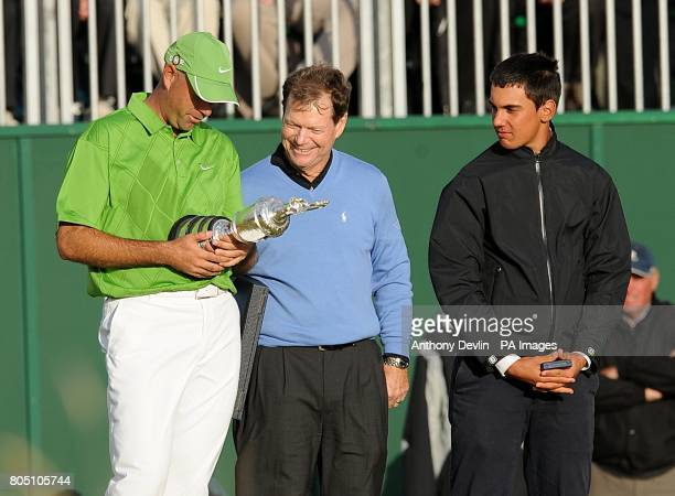 USA's Stewart Cink with the Claret Jug as Tom Watson and Matteo Manassero look on