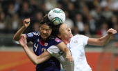 USA's striker Abby Wambach and Japan's defender Saki Kumagai vie for the ball during the FIFA Women's Football World Cup final match Japan vs USA on...