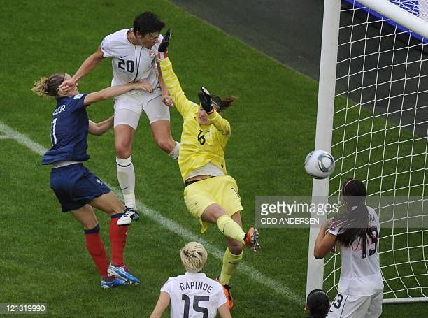 USA's striker Abby Wambach scores the 12 goal past France's midfielder Sandrine Soubeyrand during the FIFA women's football World Cup semifinal match...