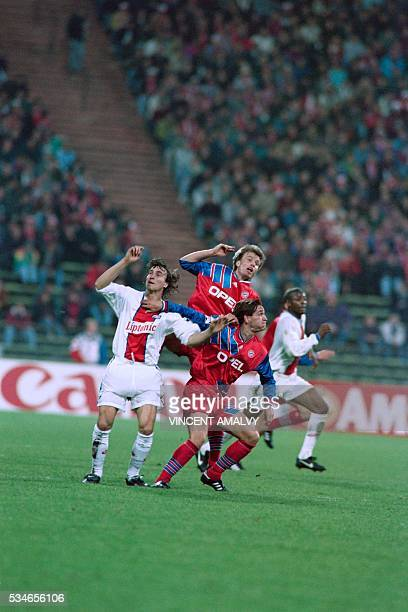 PSG's striker David Ginola struggles to get hold of the ball with Bayern of Munich's captain Lothar Matthaeus as part of the UEFA champion league...