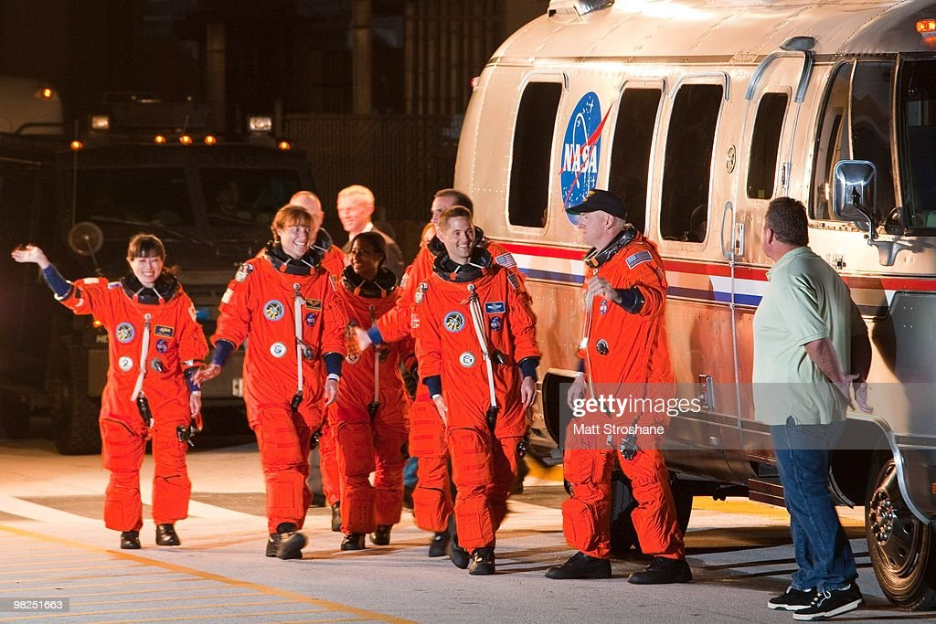 NASA's STS-131 astronauts, including Commander Alan Poindexter (2nd R), Pilot James P. Dutton Jr. (3rd R), mission specialists Rick Mastracchio, Stephanie Wilson, Dorothy Metcalf-Lindenburger, NASA astronaut Clayton Anderson, Japan Aerospace Exploration Agency astronaut Naoko Yamazaki (R) walk out of the operations and checkout building at Kennedy Space Center April 5, 2010, in Cape Canaveral. The shuttle crew is scheduled to launch later today for a 13 day trip to the International Space Station.
