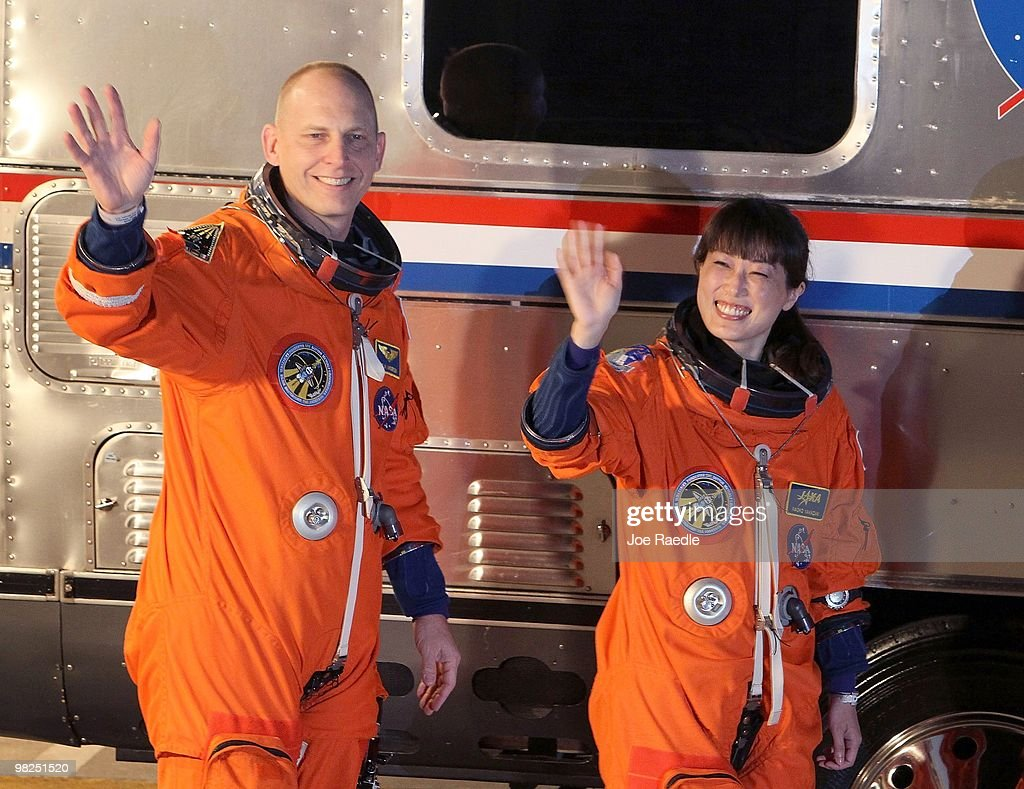 NASA's STS-131 Japan Aerospace Exploration Agency astronaut Naoko Yamazaki (R) and NASA astronaut Clayton Anderson wave as they walk out of the operations and checkout building at Kennedy Space Center April 5, 2010 in Cape Canaveral, Florida. The shuttle crews is scheduled for a 13 day trip to the International Space Station.