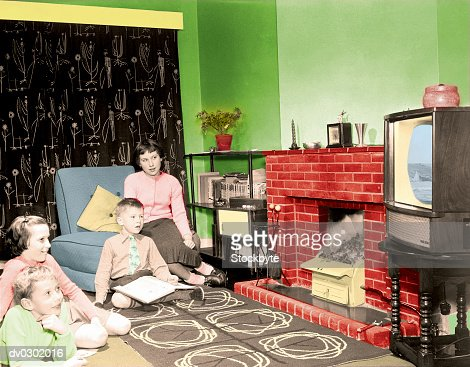 1950's Style Family Watching Television : Stock Photo