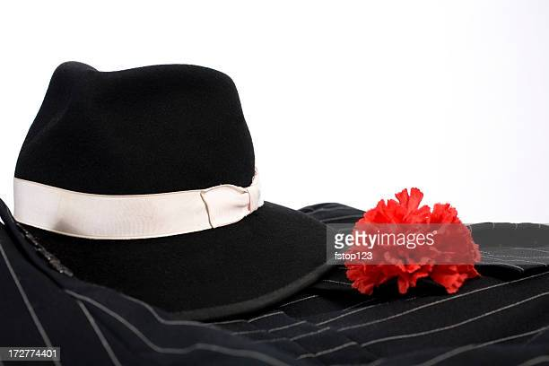 1920's suit, red carnation in lapel, fedora hat. Gangster clothing.