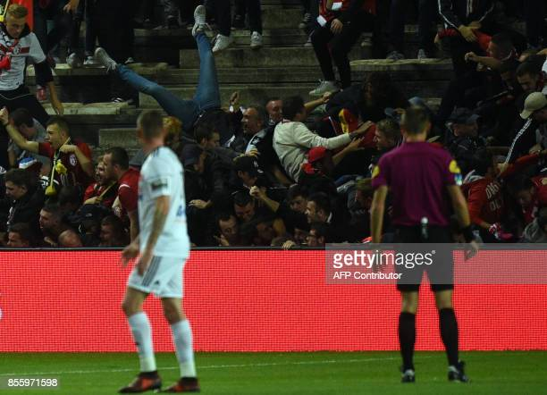 LOSC's supporters react as their tribune falls down following the goal by LOSC French defender Fode BalloToure during the French L1 football match...