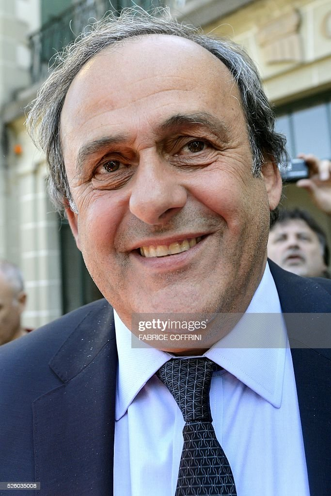 UEFA's suspended chief Michel Platini smiles as he leaves the Court of Arbitration for Sport (CAS) after his appeal hearing against his six-year FIFA ban for ethics violations on April 29, 2016 in Lausanne. CAS will rule on Michel Platini's appeal against his six-year FIFA ban by May 9, the head of the Lausanne-based tribunal Mathieu Reeb said on April 29. / AFP / FABRICE