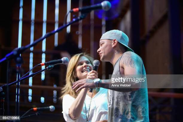 GAC's Suzanne Alexander and singer Kane Brown speak onstage at the HGTV Lodge during CMA Music Fest on June 9 2017 in Nashville Tennessee