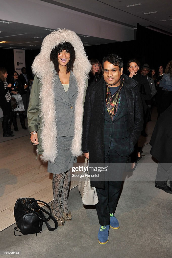ZOOMER's <a gi-track='captionPersonalityLinkClicked' href=/galleries/search?phrase=Suzanne+Boyd&family=editorial&specificpeople=234647 ng-click='$event.stopPropagation()'>Suzanne Boyd</a> and Derick Chetty attend the Holt Renfrew opening night party on March 18, 2013 in Toronto, Canada.