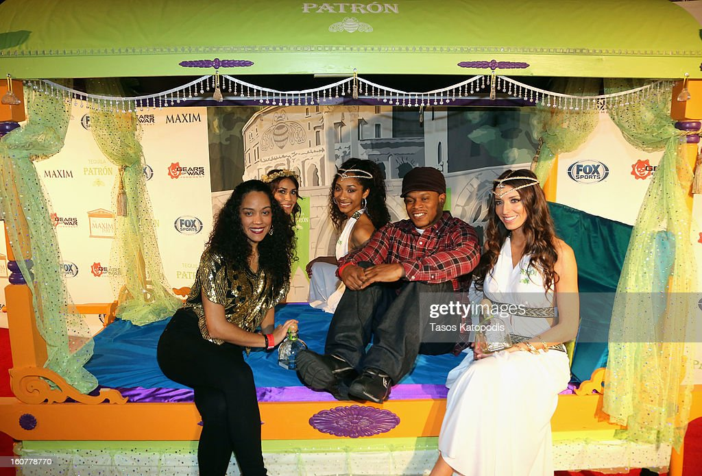 MTV's Sway Calloway (2nd from R) poses with guests at The Maxim Party With 'Gears of War: Judgment' For XBOX 360, FOX Sports & Starter Presented by Patron Tequila at Second Line Warehouse on February 1, 2013 in New Orleans, Louisiana.