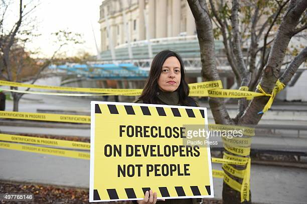 ASAP's Tamara Zahaykevich with evict landlords not people sign ASAP Artists Studio Affordability Project capped a day of protest in front of the...