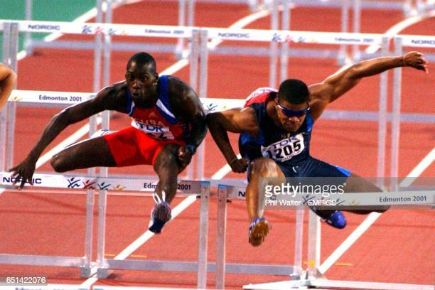 USA's Terrence Trammell and Cuba's Yuniel Hernandex nudge each other on their way to the finish line of the Mens 110 metre hurdles