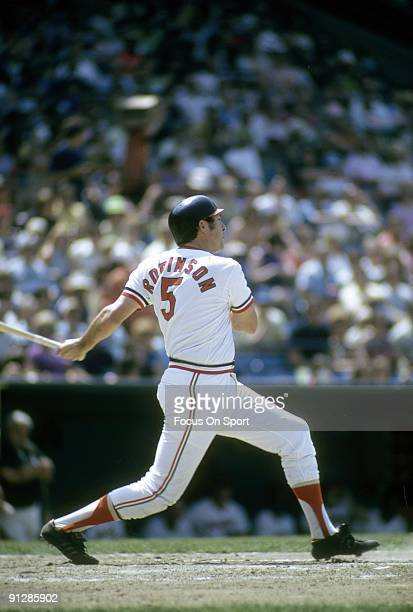 BALTIMORE MD CIRCA 1970's Third baseman Brooks Robinson of the Baltimore Orioles swings and watches the flight of his ball during a Major League...