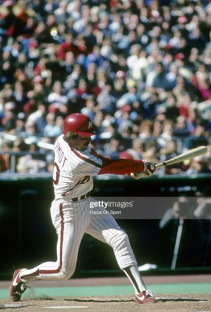 Third Baseman <a gi-track='captionPersonalityLinkClicked' href=/galleries/search?phrase=Mike+Schmidt+-+Baseball+Player&family=editorial&specificpeople=204523 ng-click='$event.stopPropagation()'>Mike Schmidt</a> #20 of the Philadelphia Phillies swings and watches the flight of his ball during a circa 1980's Major League Baseball game at Veterans Stadium in Philadelphia, Pennsylvania. Schmidt played for the Phillies from 1972-89.