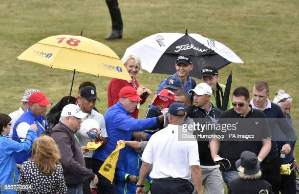 USA's Tiger Woods signs autographs during practice day four of the 2014 Open Championship at Royal Liverpool Golf Club Hoylake