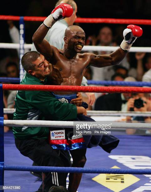 USA's Timothy Bradley celebrates at the end of the 12th round against England's Junior Witter during the WBC LightWelterweight Title bout at...