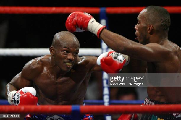 USA's Timothy Bradley on top against England's Junior Witter during the WBC LightWelterweight Title bout at Nottingham Arena