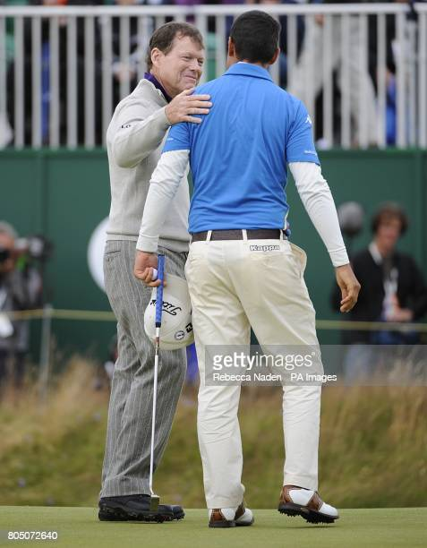 USA's Tom Watson congratulates Italy's Matteo Manassero on completing the course during the second day of the Open Championship at Turnberry Golf Club