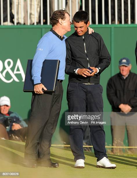 USA's Tom Watson with his runners up medal as he congratulates Italy's Matteo Manassero on winning the silver medal for leading amateur