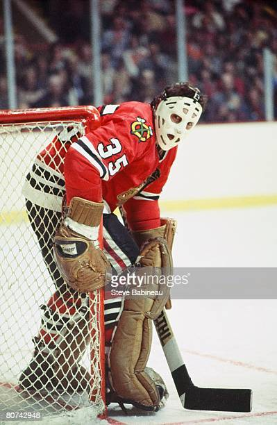 BOSTON MA 1970's Tony Esposito of the Chicago Black Hawks watches play in corner while tending goal in game against the Boston Bruins at Boston...