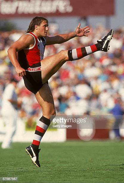 MELBOURNE AUSTRALIA 1990's Tony Lockett of Saint Kilda kicks for goal during a AFL match played at the Waverly Park in Melbourne Australia