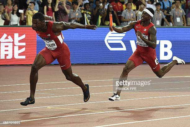 USA's Trayvon Bromell hands the baton to USA's Justin Gatlin in the final of the men's 4x100 metres relay athletics event at the 2015 IAAF World...