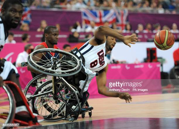 USA's Trevon Jenifer falls from his wheelchair during the men's wheelchair basketball bronze medal match between Great Britain and USA at the North...
