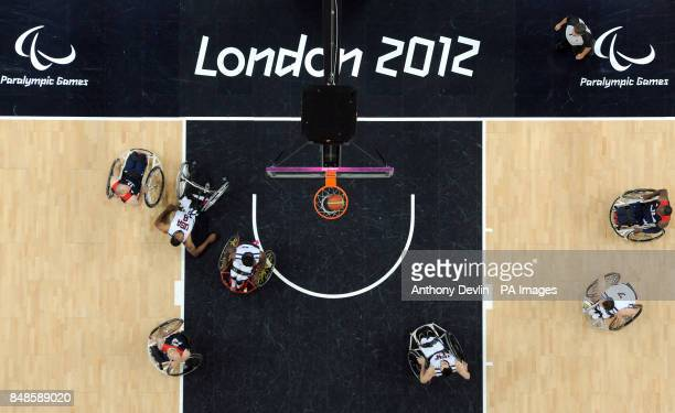 USA's Trevon Jenifer falls over as he scores during the men's wheelchair basketball bronze medal match between Great Britain and USA at the North...
