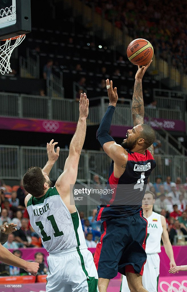 USA's Tyson Chandler (4) shoots over Lithuania's Linas Kleiza (11) during their game at the Olympic Park Basketball Arena during the 2012 Summer Olympic Games in London, England, Saturday, August 4, 2012. USA defeated Lithuania 99-94.