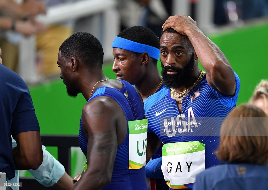 USA's Tyson Gay reacts after his team's disqualification from the Men's 4x100m Relay Final during the athletics event at the Rio 2016 Olympic Games...