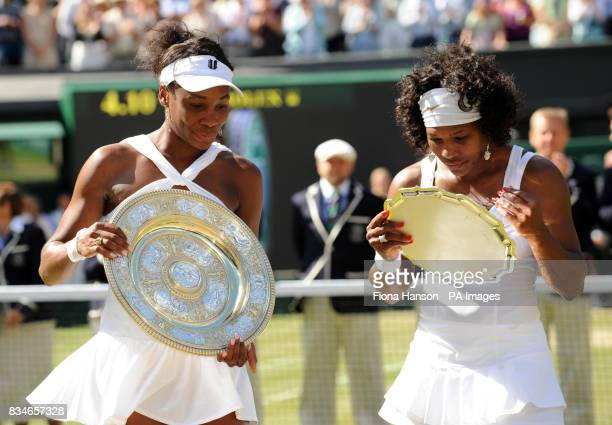USA's Venus and Serena Williams with their trophies following their Women's Final during the Wimbledon Championships 2008 at the All England Tennis...